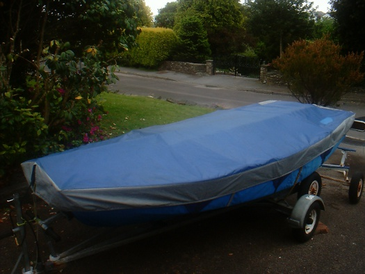 Mirror dinghy on road trailer with undercover and overcover