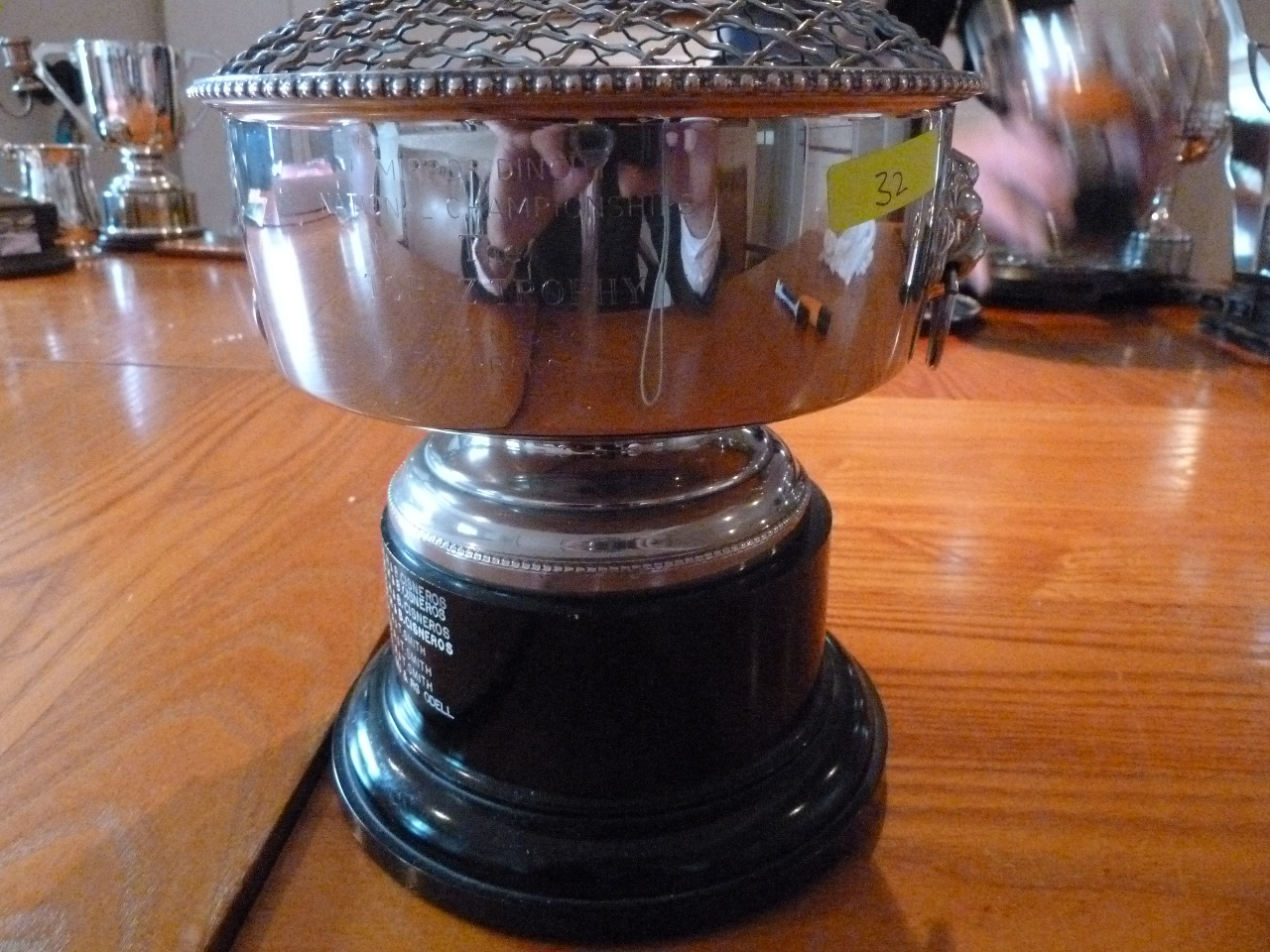 A silver rosebowl with a black plastic base